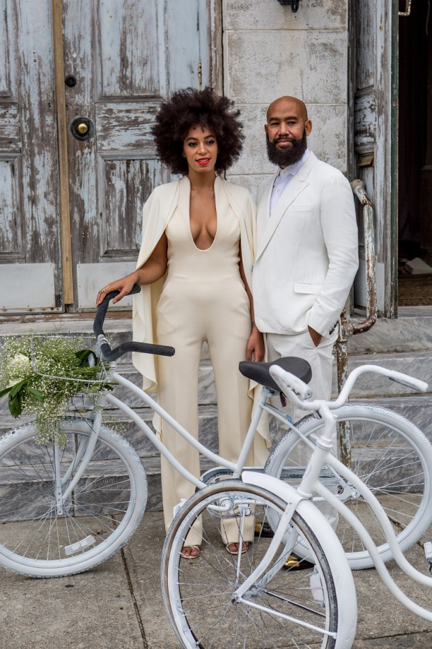 NEW ORLEANS, LA - NOVEMBER 16: Musician Solange Knowles (wearing a pre-ceremony ensemble by Stephane Rolland) and her fiance, music video director Alan Ferguson, ride bicycles on the streets of the French Quarter en route to their wedding ceremony at the Marigny Opera House on November 16, 2014 in New Orleans, Louisiana. (Photo by Josh Brastead/WireImage)