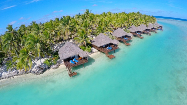 Beachfront burees at Aitutaki in the South Pacific